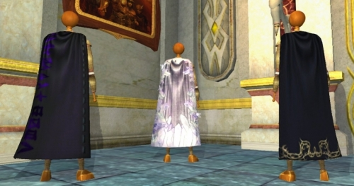 left to right: the Cloak of Runes, the Cloak of Crystal Shards and the Assassin Master's Cloak